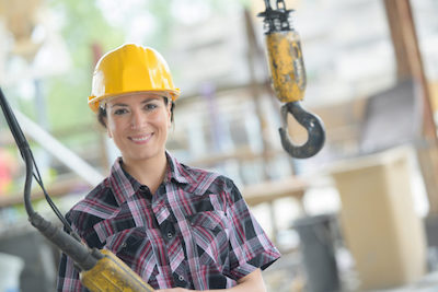 female worker at a construction site to illustrate Cost-Effective Labor