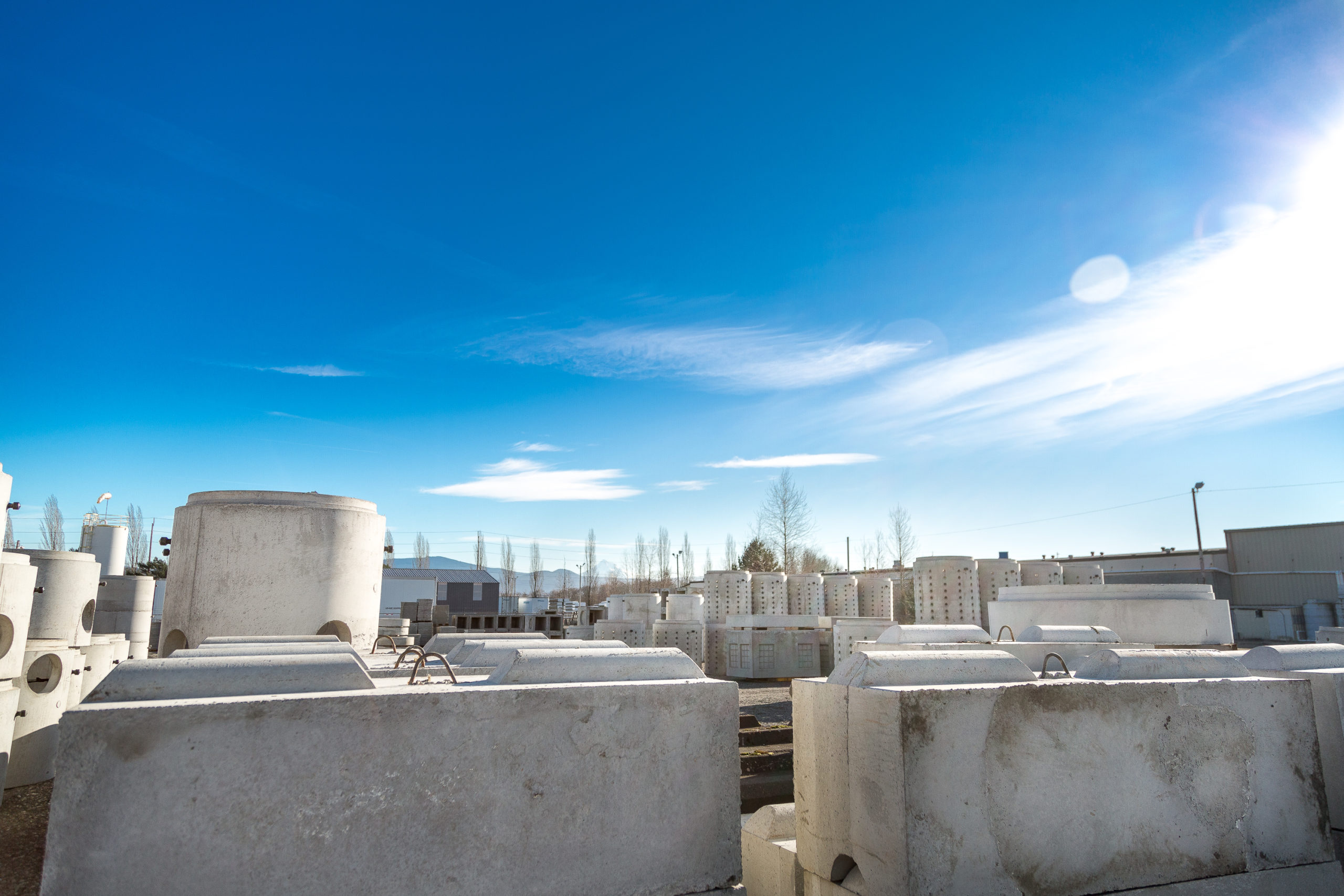 Dozens of precast concrete products in a product yard